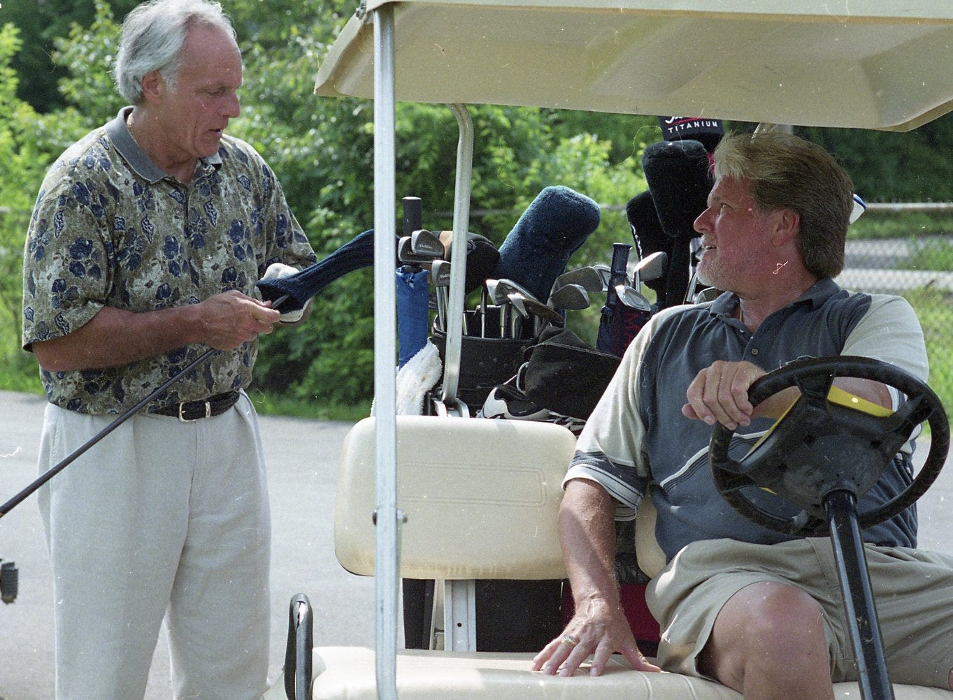 Dallas Cowboys assistant coach Joe Azezanno talks with Con Hunley between holes at the Con Hunley Golden Gloves golf tournament at Whittle Springs Golf Course. June, 2000.