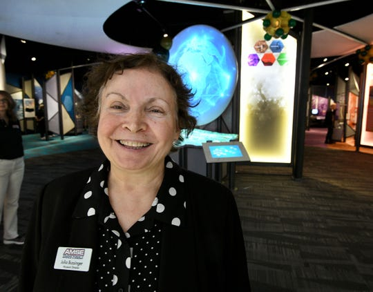 American Museum of Science and Energy Director Julia Bussinger stands near one of the interactive exhibits at the museum's new location on Main Street in Oak Ridge.