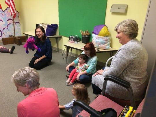 Rev. Katina Sharp, left, teaches a toddler music class.
