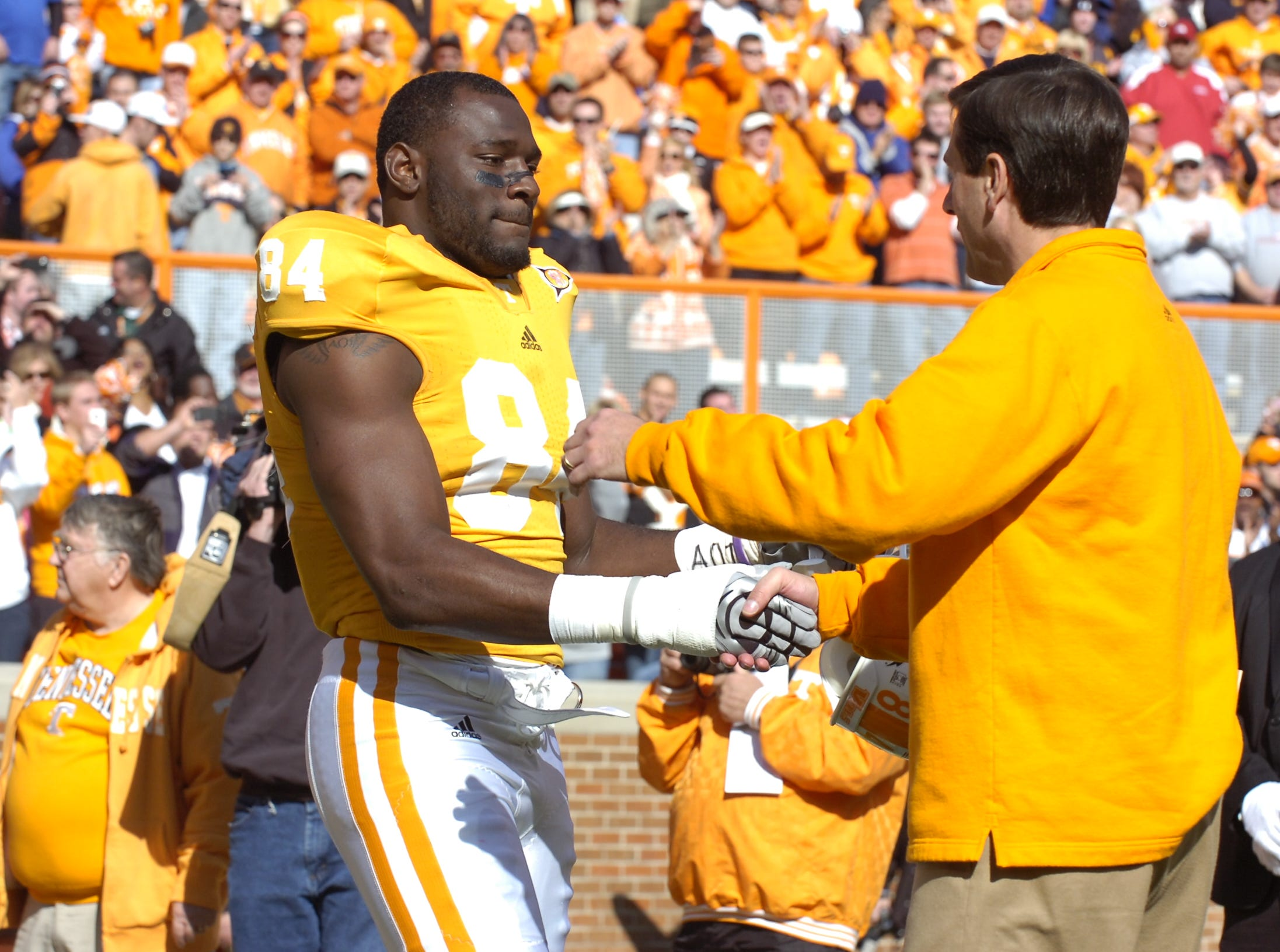 Tennessee coach Derek Dooley greets Chris Walker as part of senior day before the Kentucky game at Neyland Stadium on Nov. 27, 2010.