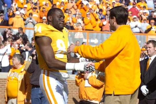 Coach Derek Dooley greets Chris Walker as part of senior day Nov. 27, 2010, at Neyland Stadium.