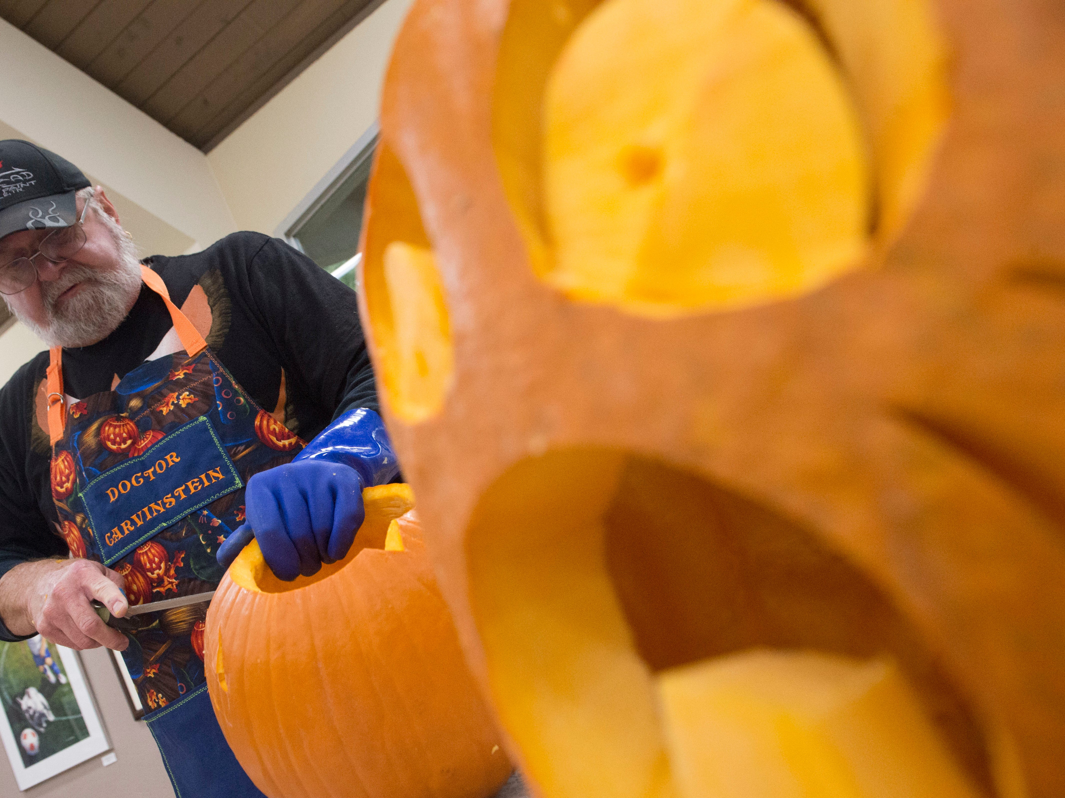 Artist Ken Clayton, also known as Dr. Carvinstein, carves pumpkins at the Fountain City Art Center, Tuesday, Oct. 16, 2018. Clayton has been carving for over 50 years.