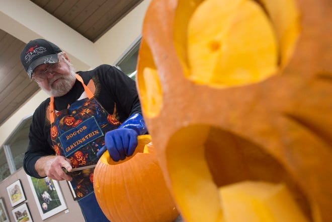Artist Ken Clayton, also known as Dr. Carvinstein, carves pumpkins at the Fountain City Art Center on Oct. 16. Clayton has been carving for over 50 years.