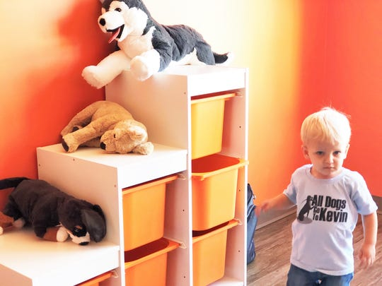 """22 month old Dexter in the kids play area at All Dogs Go to Kevin in Fountain City. While the puppies learn, there is an extra room for children to play in. """"We have a lot of kids come in, so it just made sense,"""" said owner Kevin Duggan."""