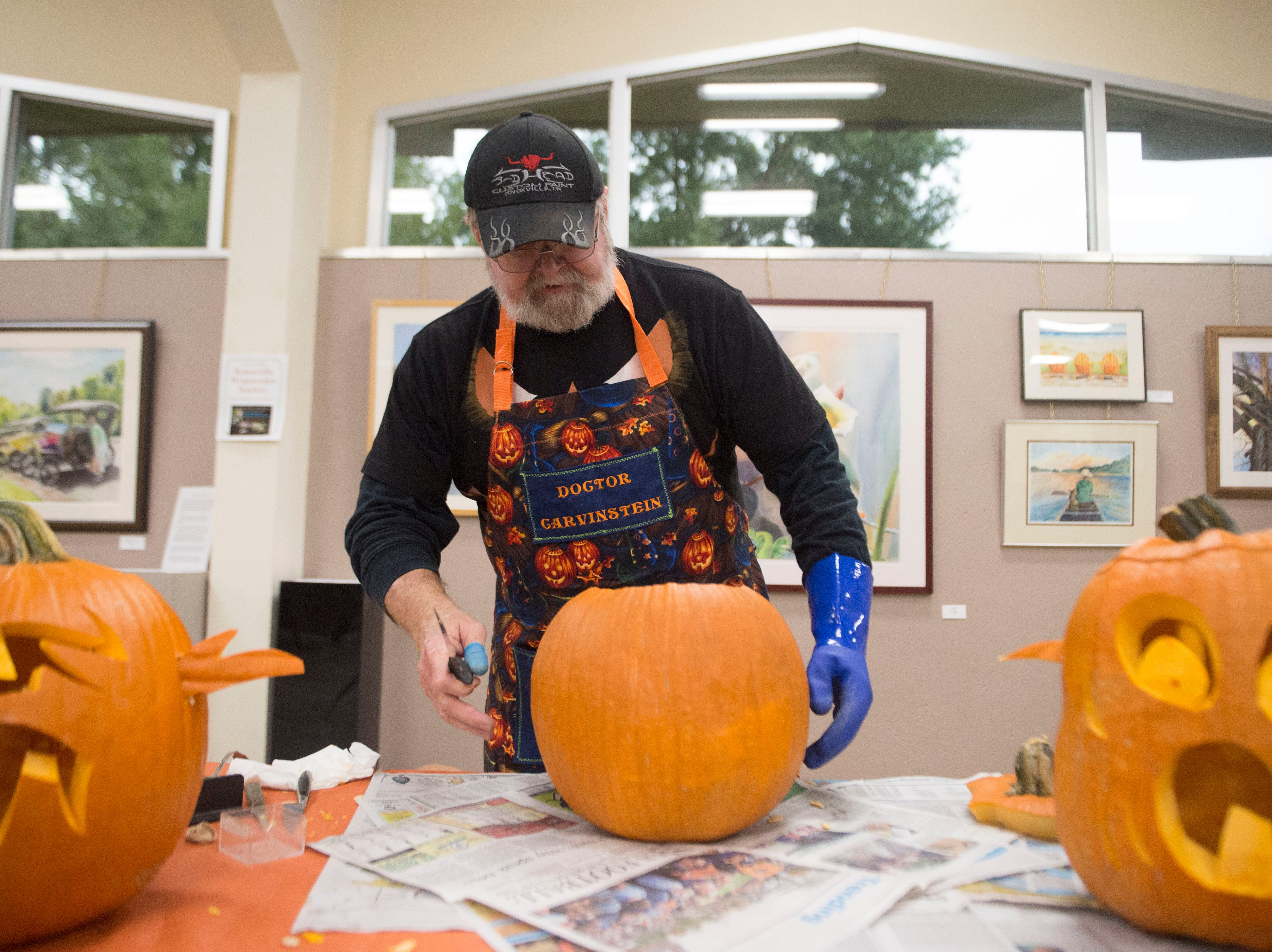 Artist Ken Clayton, also know as Dr. Carvinstein carves pumpkins at the Fountain City Art Center, Tuesday, Oct. 16, 2018. Clayton has been carving for over 50 years.