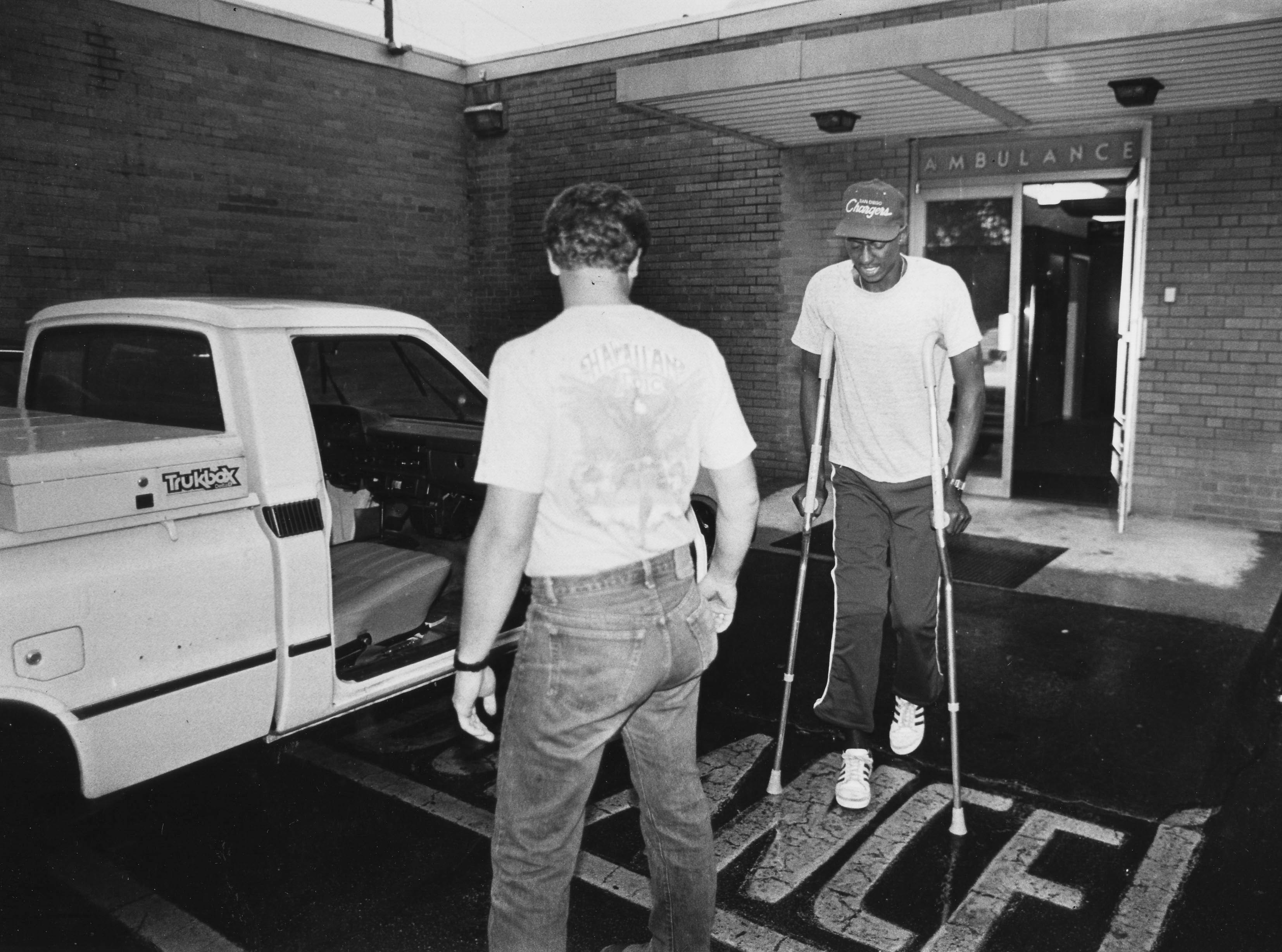 "In an Oct. 21, 1985, photograph, former University of Tennessee quarterback Tony Robinson leaves the Knoxville Orthopedic Clinic after an examination of the knee that was injured two days earlier in the Alabama game. ""I haven't gotten any sleep. All I want to do is go to my room and crash,"" said Robinson to a News-Sentinel reporter."