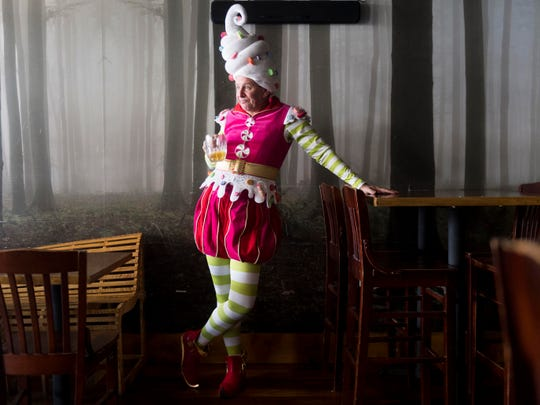 "Actor David Brian Alley is dressed as Crumpet the Elf, a character in David Sedaris' ""Santaland Diaries"" at Suttree's High Gravity Tavern."