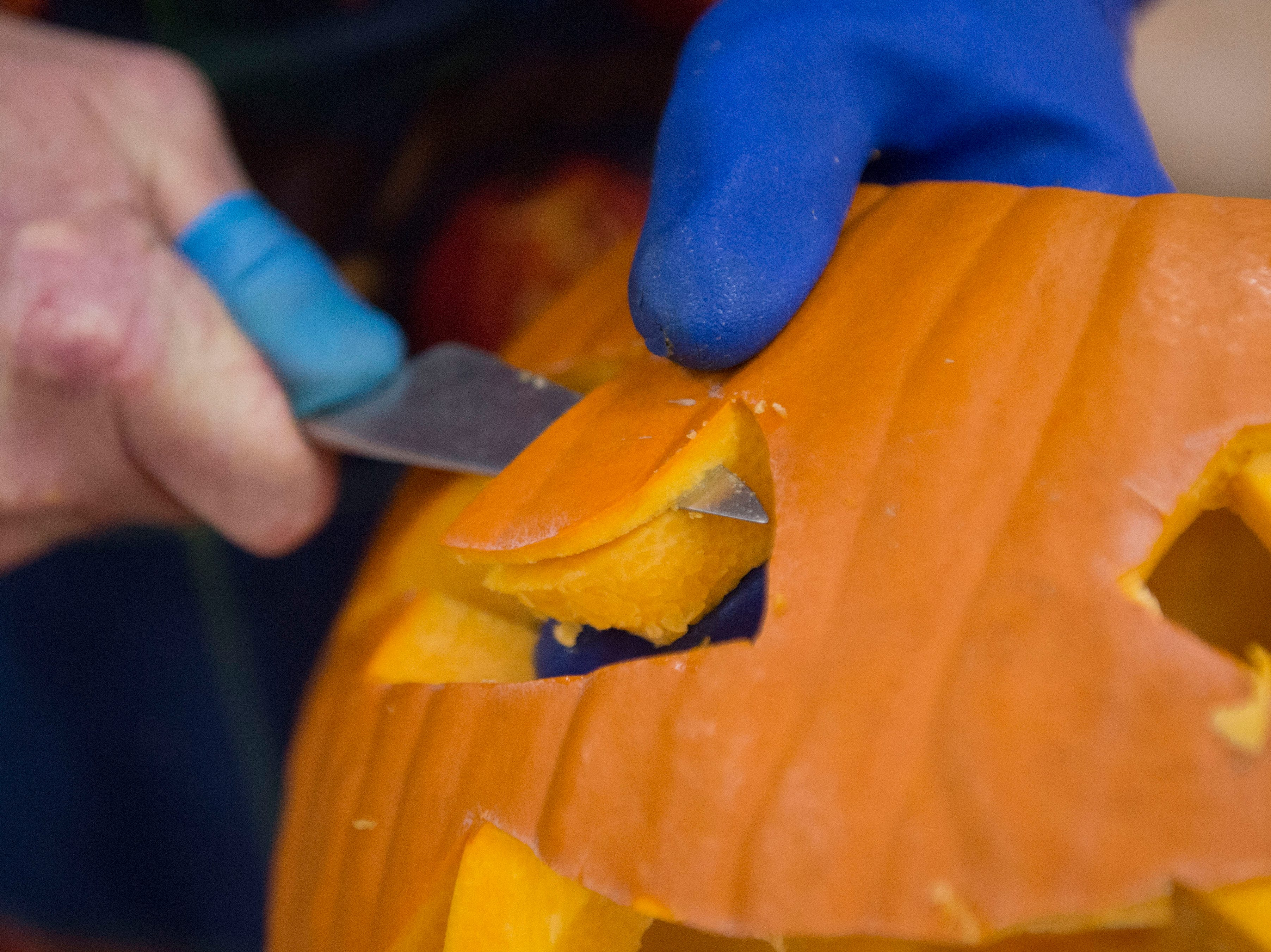 Artist Ken Clayton, also known as Dr. Carvinstein, carves pumpkins at the Fountain City Art Center on Oct. 16, 2018. Clayton has been carving for over 50 years.