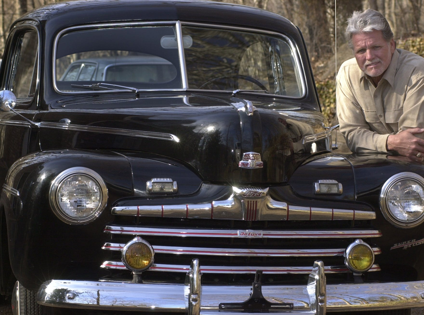 "Con Hunley stands in front of his 1946 Ford Delux Sedan that is a source of pride and joy for the country music performer.  Hunley just released an album called ""Sweet Memories."""