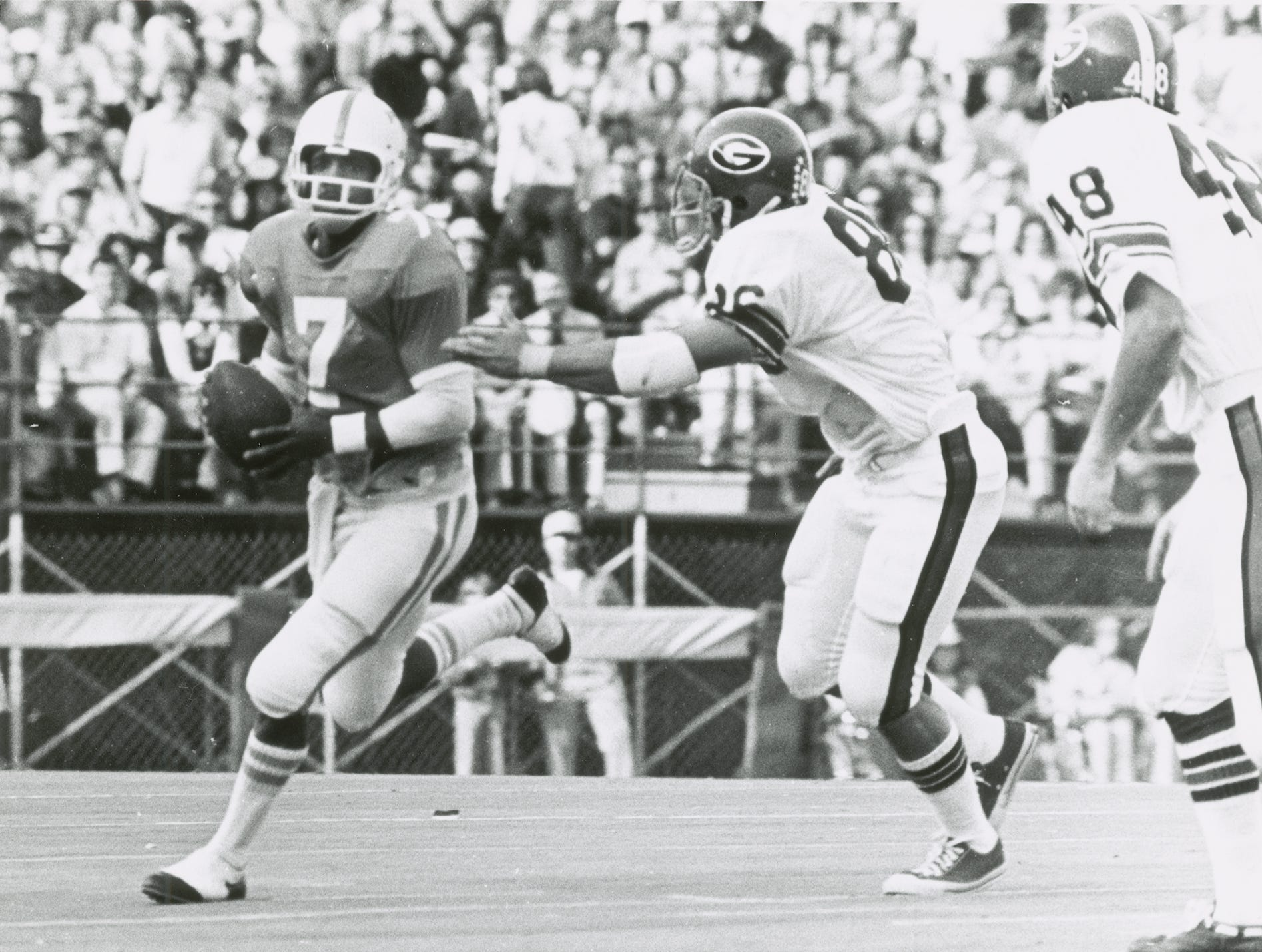 Tennessee quarterback Condredge Holloway tries to outrun a Georgia defender during a game at Neyland Stadium on Nov. 2, 1973.  The Bulldogs defeated the Vols 35-31.