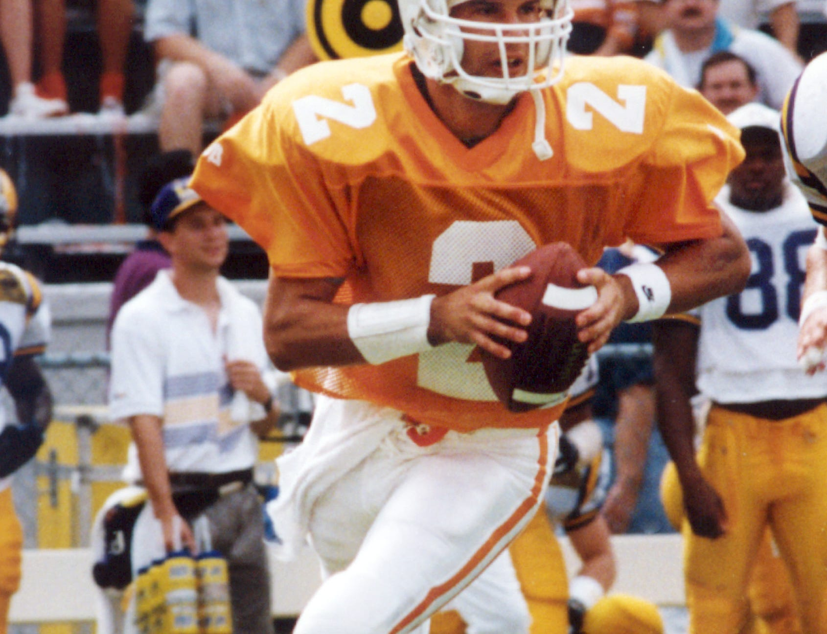 In this handout photo provided by the University of Tennessee, Tennessee quarterback Todd Helton is shown in action against against LSU in a 1993 college football game in Knoxville, Tenn. The World Series bound Colorado Rockies have connections to the first family of football, first baseman Todd Helton and outfielder Seth Smith having backed up members of the Manning family as college quarterbacks.
