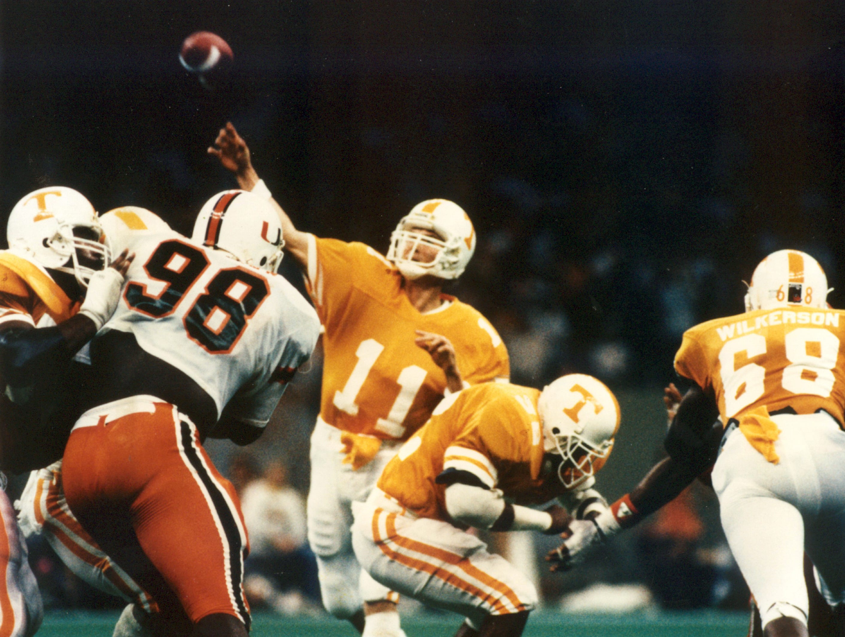 Tennessee quarterback Daryl Dickey passes the ball against Miami during the 1985 Sugar Bowl.