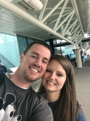 In this selfie provided by Clark and Heather Ensminger, Clark Ensminger, left, poses with his wife Heather in Nashville, Tenn., marking the cross-country trip they are taking to see every U.S. Disney park in a single day. (Courtesy of Clark and Heather Ensminger via AP)
