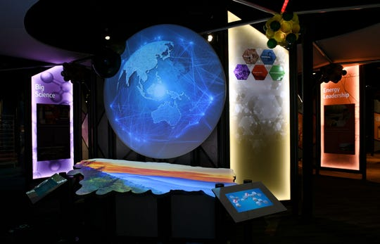Visitors enjoy the interactive exhibits at the new American Museum of Science and Energy at their new location on Main Street.