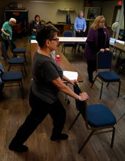 Chris Sulick leads a balance training class in exercises designed to increase balance and decrease the chance someone falls Wednesday, Oct. 17, 2018, at Olivedale Senior Center in Lancaster.