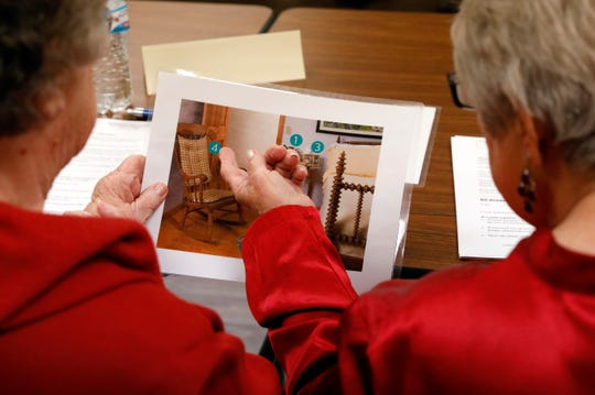 Irene Osborne, right, points to a potential tripping hazard in a photograph as she and Neva Nameth, left, try to identify hazards in the room depicted Wednesday, Oct. 17, 2018, at Olivedale Senior Center in Lancaster. Osborne and Nameth were participating a balance training class designed to help senior citizens decrease their chance of falling.