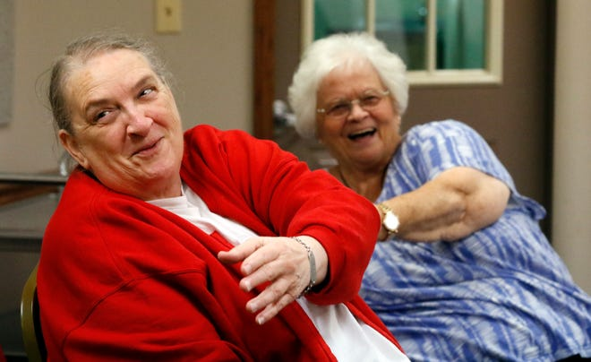 Joanne Hurst, left, and Marilyn Hock do exercises designed to help them stretch and increase their balance Wednesday, Oct. 17, 2018, during a balance training class at Olivedale Senior Center in Lancaster.