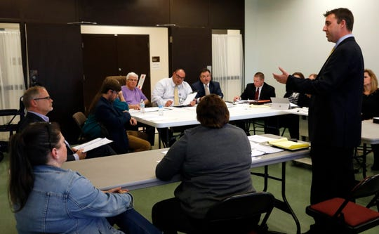 Chris Weist, right, questions Chris Chapman during a hearing Thursday, Oct. 17, 2018, at the Fairfield County Board of Elections. Chapman had filed a challenge questioning whether Weist's client Kryssi Wichers was legally registered to vote in Fairfield County. The board unanimously dismissed the claim, allowing Wichers to remain a registered voter and to continue running for the Ohio House 77th District seat.