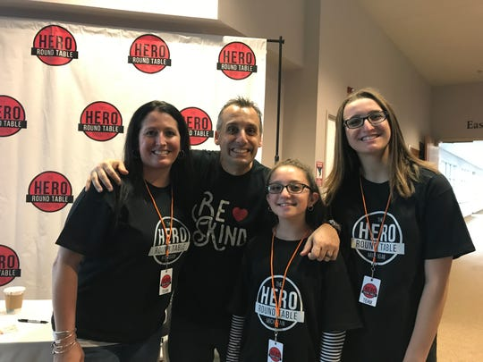 """TV show """"Impractical Jokers"""" star Joe Gatto poses with, from left, Kristy Ellis, Sophia Cipolla, Bella Cipolla at last year's Hero Round Table, Sunday Oct. 15, 2017. He will speak at the event again this year."""