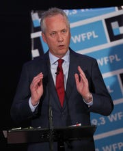 Mayor Greg Fischer made opening remarks during a mayoral debate against Councilwoman Angela Leet at the WFPL studio. 