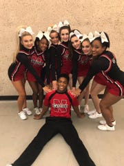 Koran Givens plays linebacker at New Albany. He's also a cheerleader for the boys' basketball team.