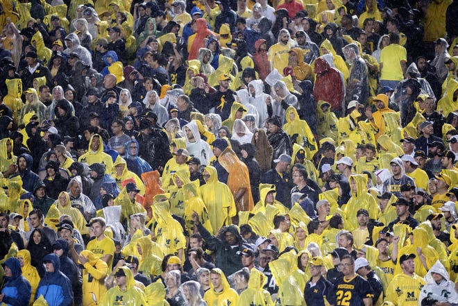 Fans watch the action in the rain during the third quarter of the Michigan State vs. Michigan game on Saturday, Oct. 7, 2017, at Michigan Stadium in Ann Arbor.
