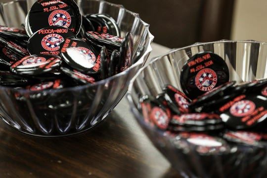 October 16 2018 - United Education Association buttons are seen during a rally held by the United Education Association at the Shelby County Schools headquarters on Tuesday.