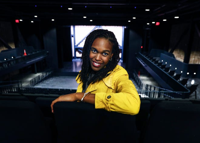 Crosstown Arts theater director Jazmin 'Jazzy' Miller sits in a new multi-use theater at Crosstown Concourse.
