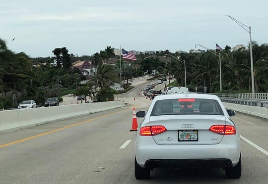 Brake lights, orange cones and long lines surprised commuters to and from Marco Island on October 8.