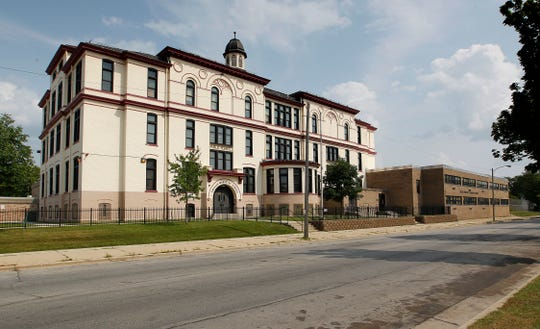 A proposal to convert the former Phillis Wheatley Elementary School into apartments is among several Milwaukee-area affordable housing developments that are receiving federal tax credits.