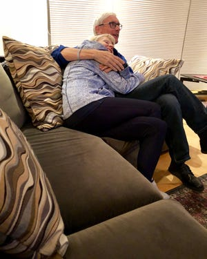 Tony and Kathy Evers settle in in their Madison living room to watch Game Four of the National League Championship Series between the Milwaukee Brewers and Los Angeles Dodgers.