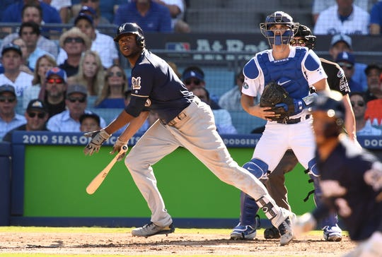 Brewers center fielder Lorenzo Cain watches his RBI double in last year's NLCS.