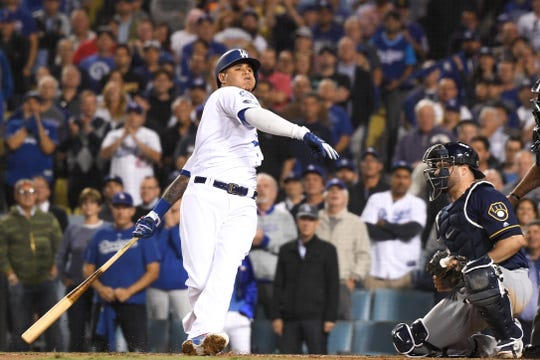 It's a mighty swing and a mighty whiff as Manny Machado of the Dodgers strikes out against Brewers reliever Josh Hader in the eighth inning of Game 4 on Tuesday night.