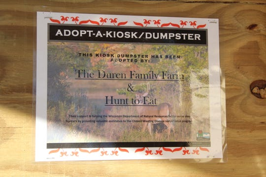 A certificate recognizes the sponsors of the first kiosk and dumpster adopted under a program organized by the Wisconsin Department of Natural Resources. The facility is located on private land owned by the Duren Family Farm near Cazenovia, Wisconsin.