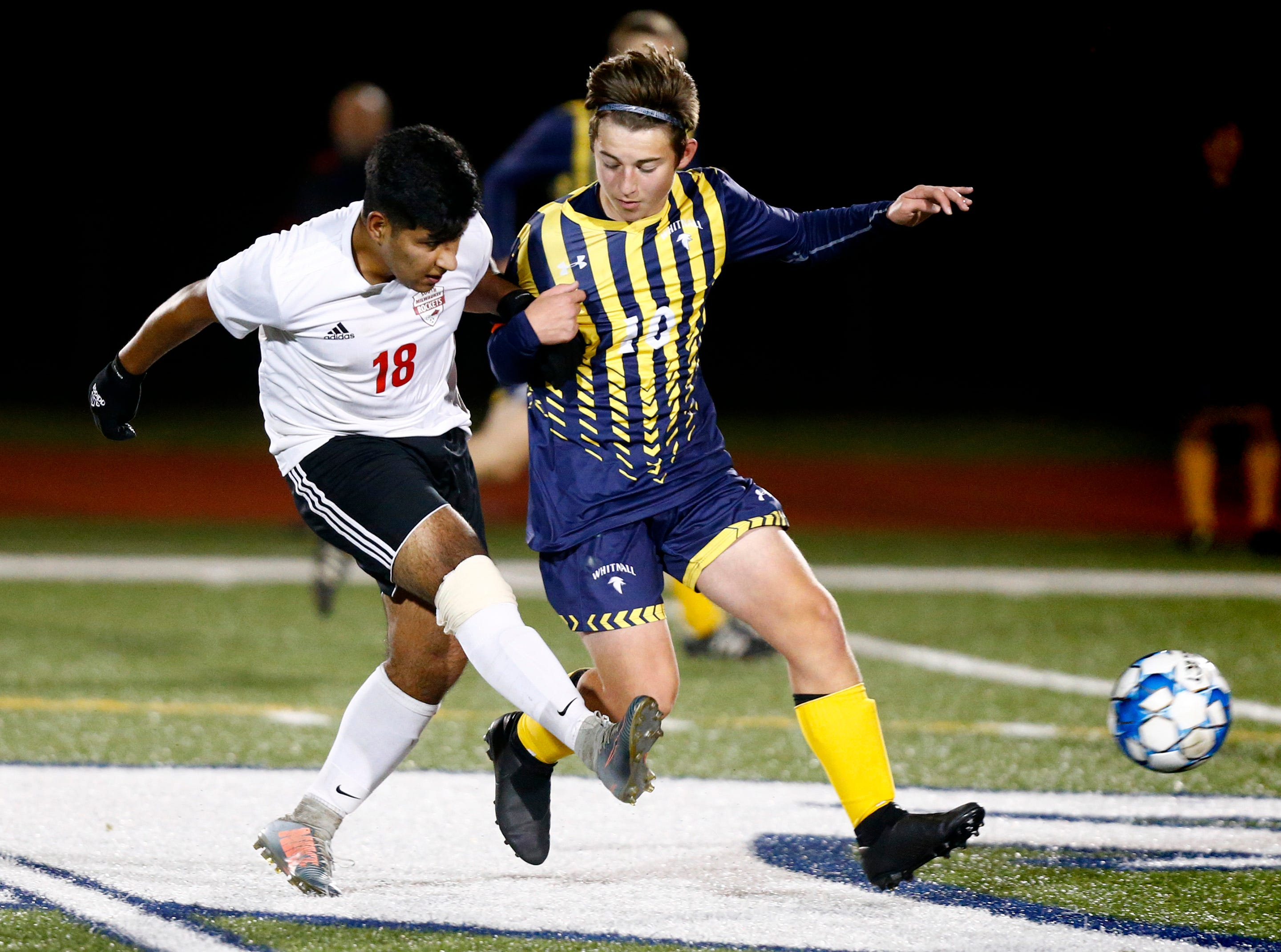 South Milwaukee's Oscar Calderon sends the ball past Whitnall's Brady Korpal in WIAA semi-regional play at Whitnall on Oct. 16.