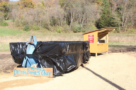 A deer carcass dumpster (left) and a CWD sampling kiosk have been established on the Duren Family Farm near Cazenovia, Wisconsin. The Duren Family Farm and Hunt to Eat adopted the dumpster and kiosk under a new program organized by the Wisconsin Department of Natural Resources.