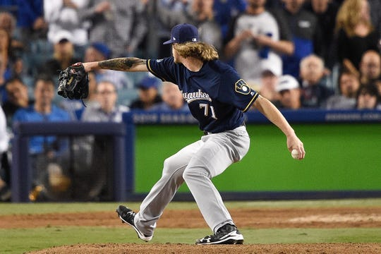 Brewers reliever Josh Hader gets ready to fire in a pitch against the Dodgers during the eighth inning of Game 4 on Tuesday.