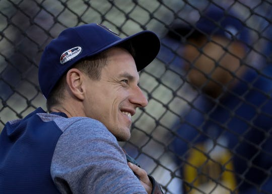 Milwaukee Brewers manager Craig Counsell watches batting practice before Game 4 of the National League Championship Series baseball game against the Los Angeles Dodgers Tuesday, Oct. 16, 2018, in Los Angeles. (AP Photo/Matt Slocum) ORG XMIT: NLCS104