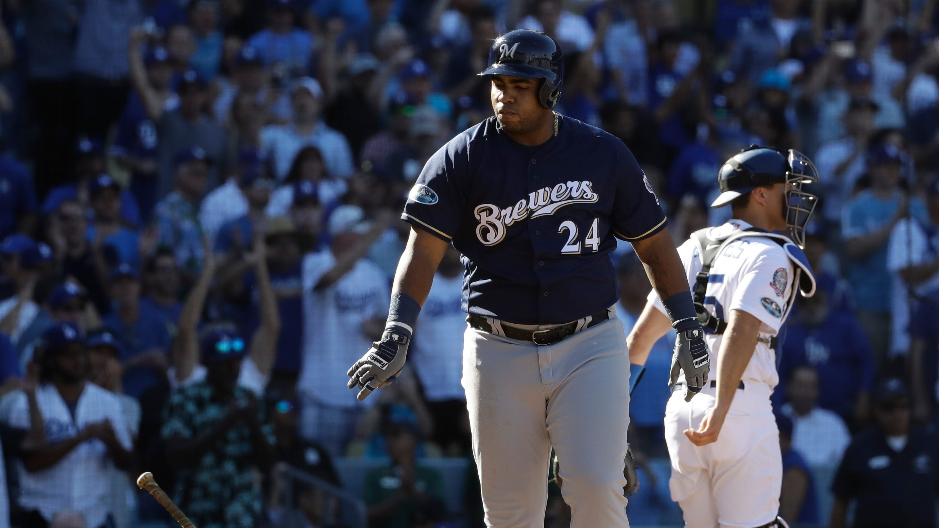 Jesus Aguilar reacts after striking out with bases loaded.