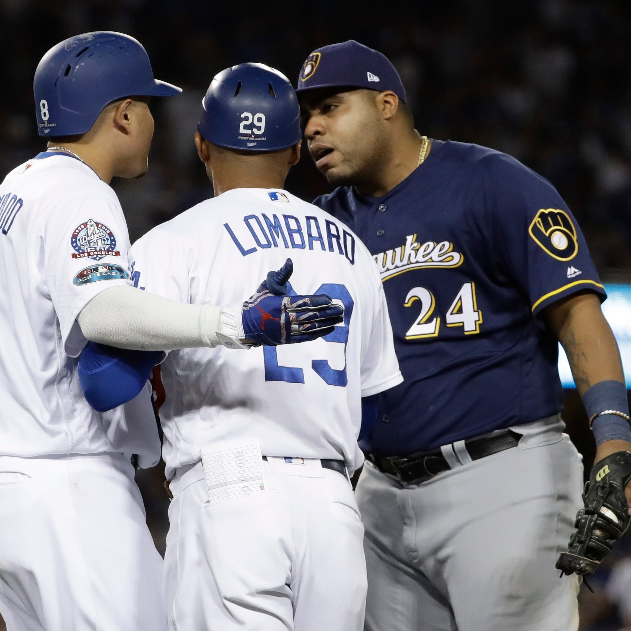Brewers first baseman Jesus Aguilar has something to say to Manny Machado after the Dodgers shortstop clipped his heel on a groundout in the 10th inning of Game 4 on Tuesday.