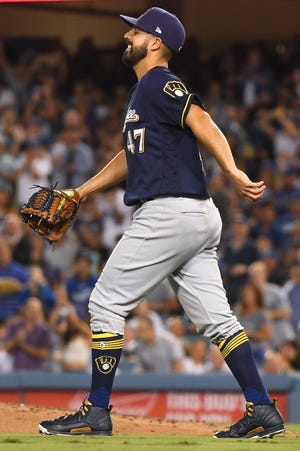 LOS ANGELES, CA - OCTOBER 16:  Gio Gonzalez #47 of the Milwaukee Brewers reacts after making a play on a ball hit by Yasiel Puig #66 of the Los Angeles Dodgers (not pictured) during the second inning in Game Four of the National League Championship Series at Dodger Stadium on October 16, 2018 in Los Angeles, California. Gonzalez would be injuried on the play and leave the game later in the inning.  (Photo by Harry How/Getty Images)