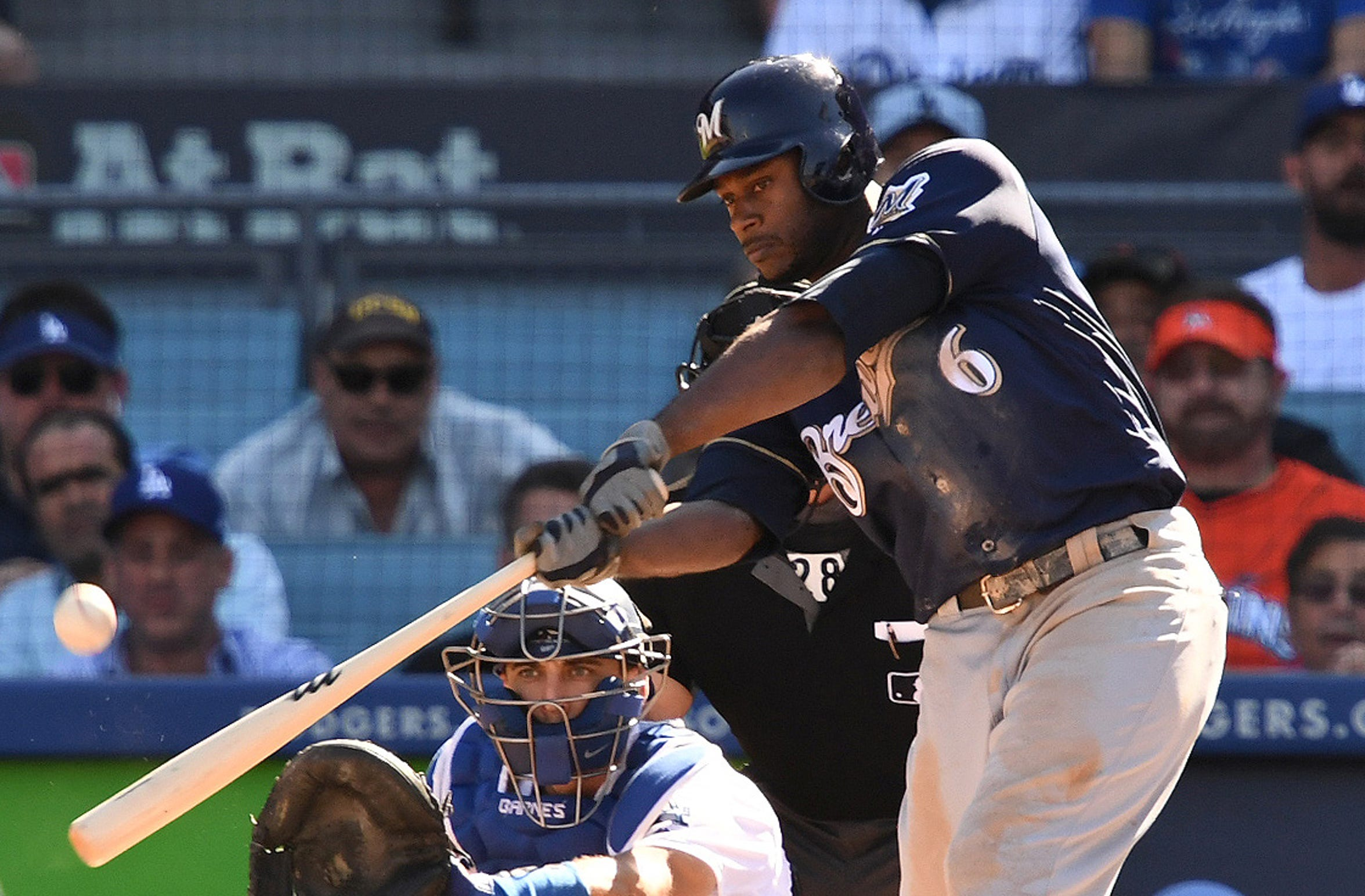Brewers center fielder Lorenzo Cain  hits an RBI double.