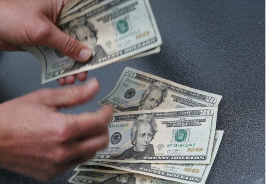 Money Elise Amendola Associated Press