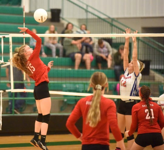 Flippin's Haylee Marberry hits against Midland on Tuesday night.