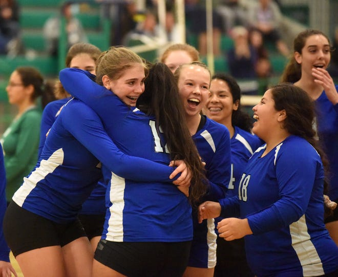 Cotter Lady Warriors celebrate after winning their district semifinal match against Yellville-Summit on Tuesday night.