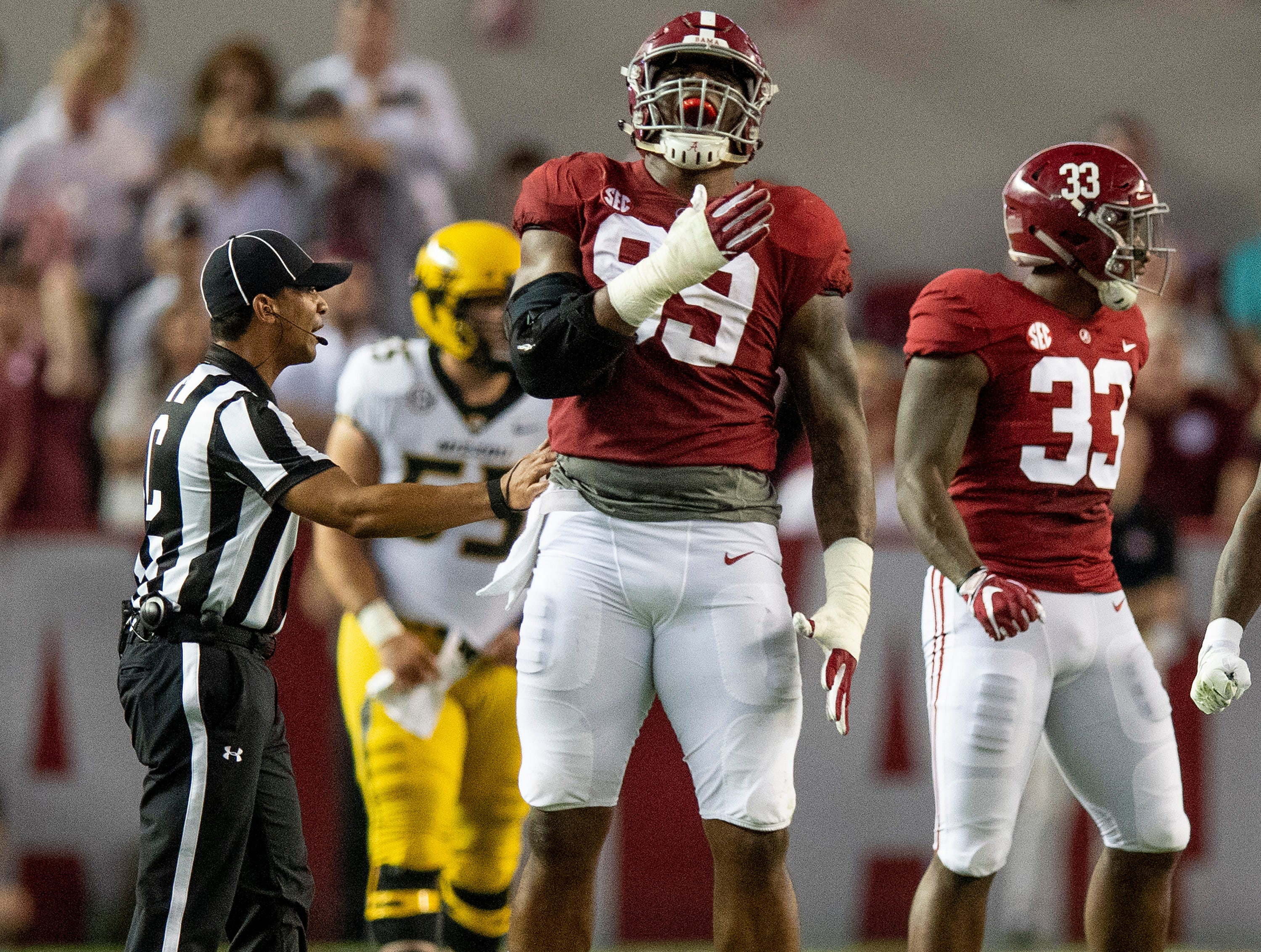 Alabama defensive lineman Raekwon Davis (99) celebrates a tackle for a loss against Missouri in first half action at Bryant Denny Stadium in Tuscaloosa, Ala., on Saturday October 13, 2018.