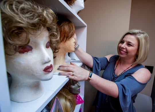 Tisha Ward works with wigs for cancer patients as part of her job at the American Cancer Society in Montgomery, Ala., on Tuesday October 16, 2018.