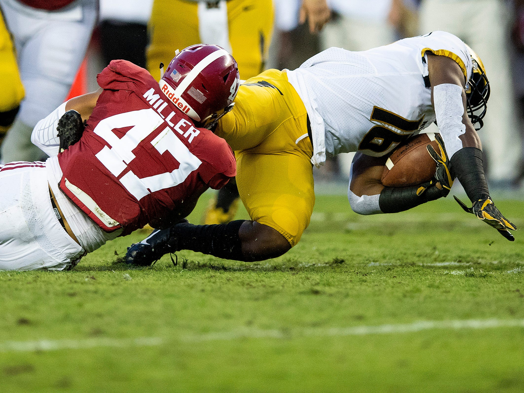 Alabama linebacker Christian Miller (47) tackles Missouri running back Damarea Crockett (16) in first half action at Bryant Denny Stadium in Tuscaloosa, Ala., on Saturday October 13, 2018.
