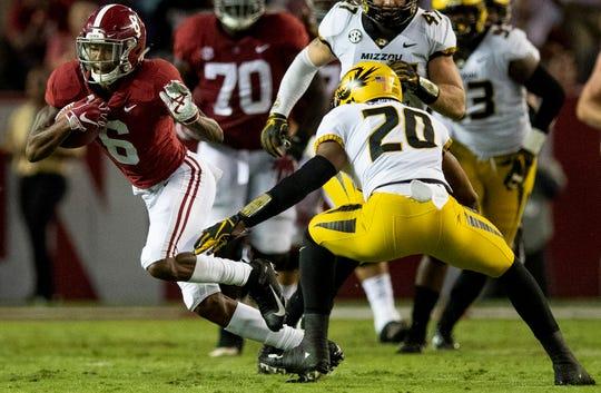 Alabama wide receiver DeVonta Smith (6) eludes Missouri defensive back Khalil Oliver (20) in first half action at Bryant Denny Stadium in Tuscaloosa, Ala., on Saturday October 13, 2018.