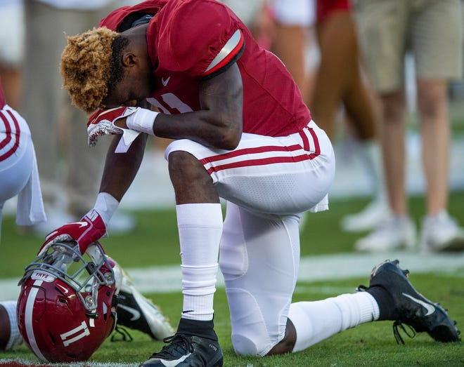Alabama wide receiver Henry Ruggs, III, (11) kneels in prayer before the Missouri game at Bryant Denny Stadium in Tuscaloosa, Ala., on Saturday October 13, 2018.